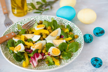 Spring Easter Salad With Chicken And Quail Eggs, Corn Salad, Pepper, Green Peas, Painted Eggs. Easter Concept.