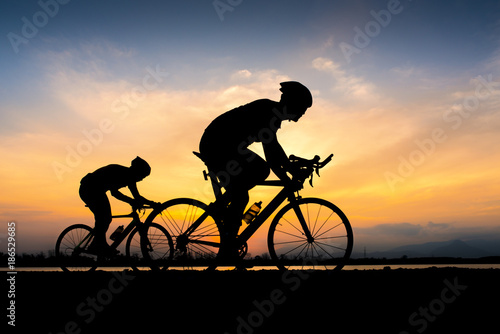 Aluminium Prints Cycling Cyclist in maximum effort in a road outdoors at sunset