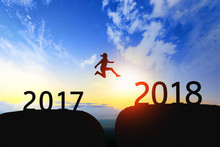 Woman Jump Through The Gap Between 2017 To 2018 On Sunset.