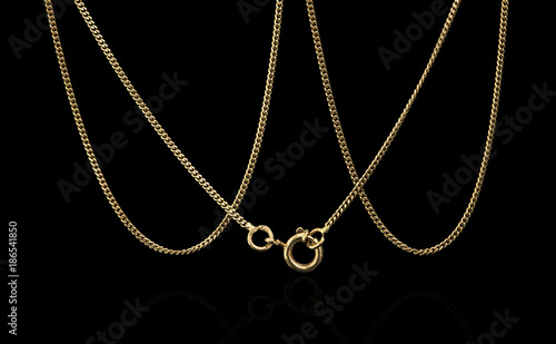 Unique gold necklace isolated on black background, macro closeup showing yellow Canvas Print