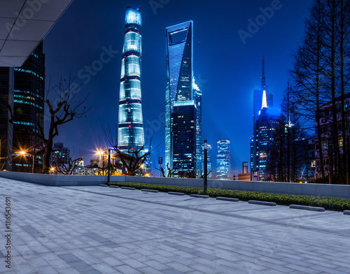 cars motion blur on city road at night in shanghai financial and trade zone Poster