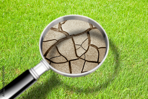 Cracked ground seen through a magnifying glass - The effects