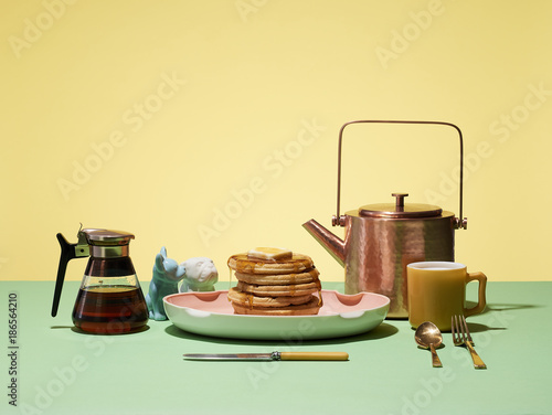 Morning Breakfast Scene with Pancakes Waffles and Syrup Coffee - 186564210