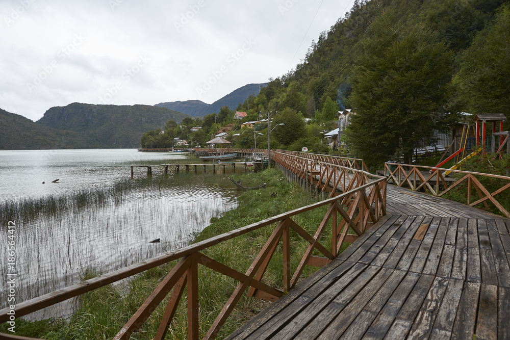 Wooden walkway in the coastal village of Tortel built into the steep hillsides of northern Patagonia in Chile.