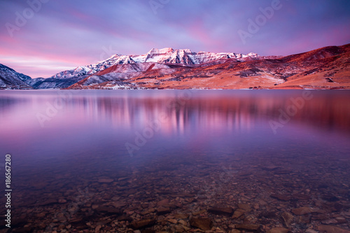 Fotobehang Aubergine Winter dawn reflection in Deer Creek, Utah, USA.