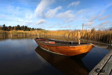 Single Wooden Boat On A Lake