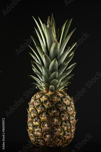 Fototapety, obrazy: Pineapple on a black background