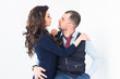 A beautiful loving couple in a living room at home on white background. A youth couple in love