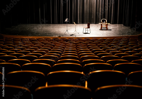 Foto op Canvas Theater Brown wooden chairs in the auditorium without people, visible podium