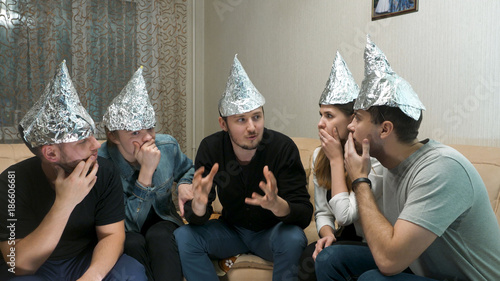 Fotografie, Obraz  Group of people with foil on their heads discussing conspiracy theories