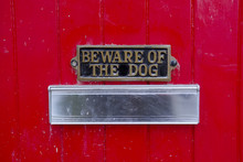 Beware Of Dog Sign On Front Ga...
