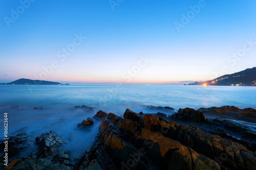 Keuken foto achterwand Landschap Dramatic sky seascape with rock in sunset scenery background.