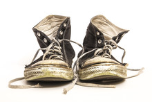 Pair Of Men's Or Teenager's Worn Out Dirty High Top Black And White Athletic Tennis Shoes Isolated On White Background
