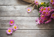 Pink Flowers On Old Wooden Background