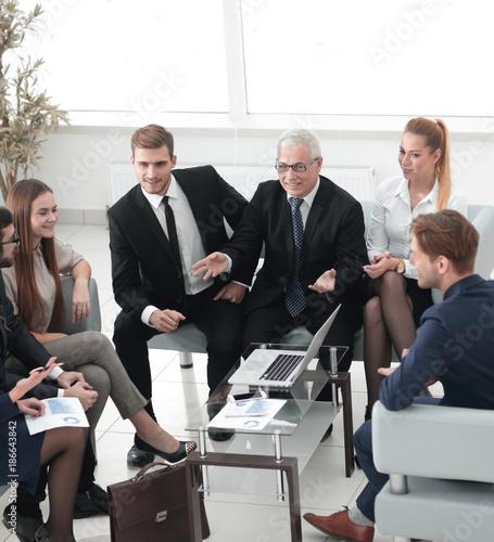 Fototapeta business partners and business team discussing a new contrac obraz na płótnie