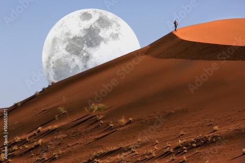 Dune walking in the Namib Desert at Sossusvlei in Namibia