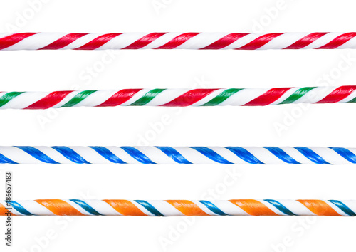 Candy cane. Set of different striped twisted handmade candy canes border sticks.