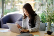 Shot of a young Asian businesswoman working on her laptop in the office