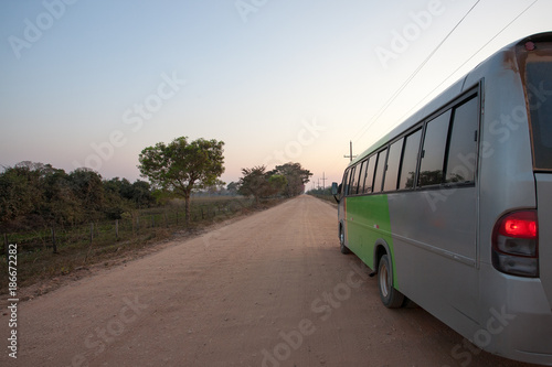 Fotografija  Bus in perspective along dirt road