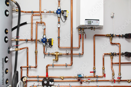 Fotomural Heating system with copper pipes, valves and other equipment