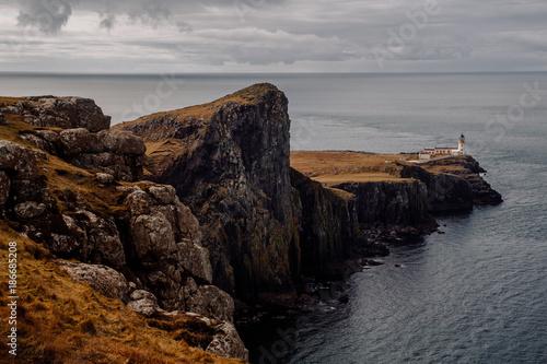 Scenic view of Neist Point Lighthouse on coastal hill†near sea