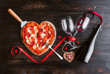 A Festive Dinner Of Pizza In The Shape Of A Heart And A Bottle Of Wine.