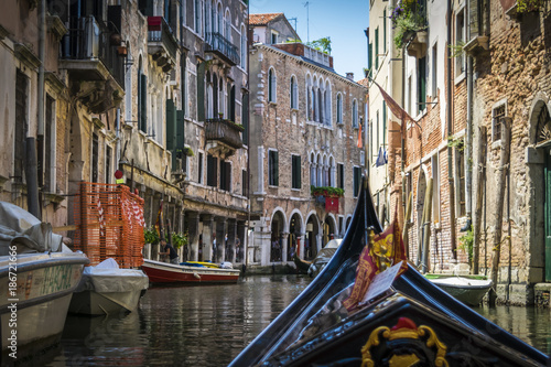 Türaufkleber Gondeln Canals and historic buildings of Venice, Italy, from gondola. Narrow canals, old houses, reflection on water on a summer day in Venice, Italy.