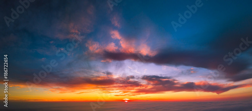 Panoramic aerial view of flying between the cloud at sunset Canvas Print