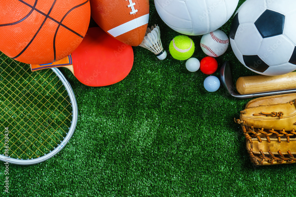 Fototapeta Sports Equipment on green grass, Top view