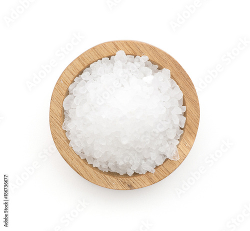 Fototapeta Sea salt in a wooden bowl top view isolated on white background. obraz