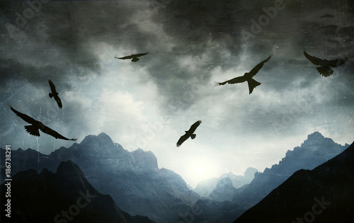 Gothic landscape mountain range with hawks
