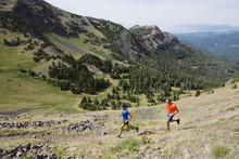 Happy Couple Running Mountain ...