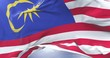 Flag of Malaysia waving at wind with blue sky in slow, loop