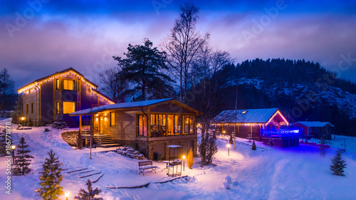 Spoed Foto op Canvas Purper Village village. Three houses. Snow-covered houses. The village is under the snow.