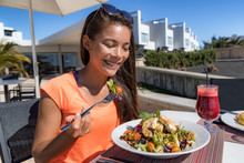 Summer Food Asian Woman Eating Vegetarian Goat Cheese Salad At Luxury Travel Resort After Fitness Exercise. Fit Young Girl On Weight Loss Diet At Restaurant.