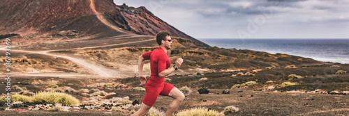 Runner trail running athlete man training cardio in landscape banner background. Sport outdoor in nature. Ultra run race.