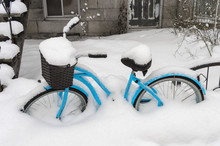 Blue Bike Covered In Snow Afte...