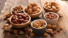 Assorted Nuts On Wood Background