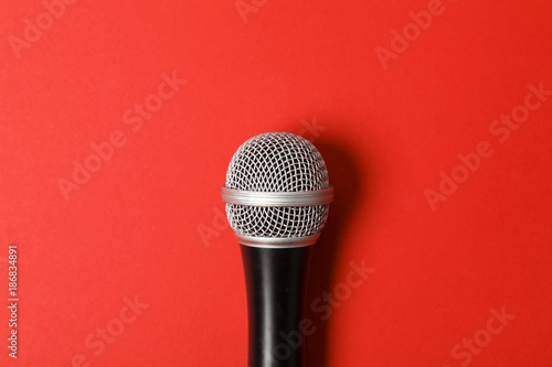 microphone on a bright red background. - 186834891