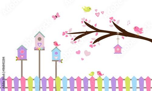 Rama de árbol, nidos y valla de colores. Canvas Print
