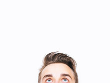 Close Up Of Young Man Eyes Looking Up And White Background