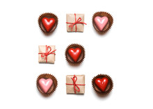 Minimal Styled Valentine's Day Flat Lay Top View Isolated On White Background. Gifts And Chocolate Heart-shaped Candies In Geometric Rows. Copy Space. Love Concept. St Valentine's Pattern