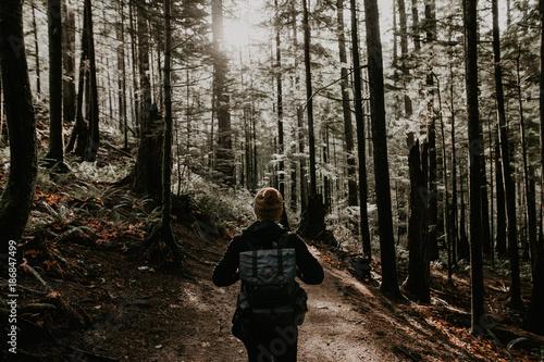 Man walking in autumn forest