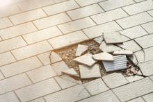 Cracked And Broken Tiles Floor .
