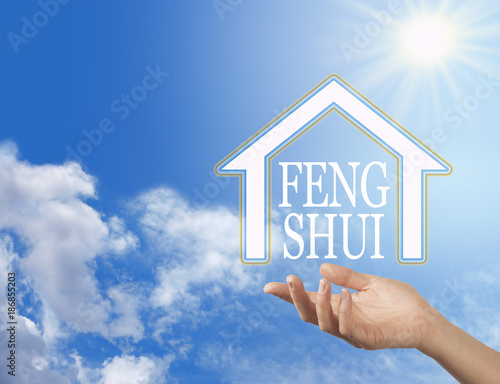 Photo  Let the Enlightened Wisdom of Feng Shui into your Home - female hand with a hous