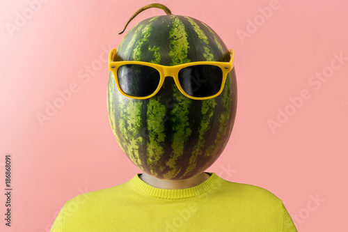 A man with a watermelon instead of head. Minimal concept.