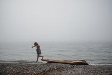 Girl On Beach Playing On Drift...