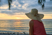 A Female Tourist Watching A Su...