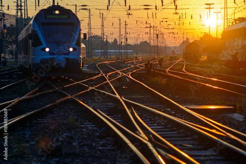 Fotomural Passenger train on rail track intersection