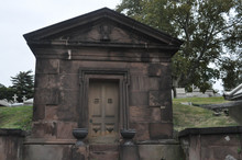 Old Stone Mausoleum In A Cemet...